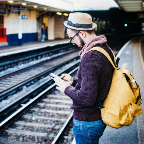 man waiting for train_phone